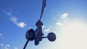An anemometer turns, working outdoors.