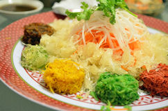 A special dish during Chinese New Year called Yusheng or Yee Sang Stock Photos