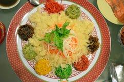 A special dish during Chinese New Year called Yusheng or Yee Sang Royalty Free Stock Photos