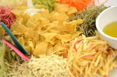 A special dish during Chinese New Year called Yusheng or Yee Sang Royalty Free Stock Images