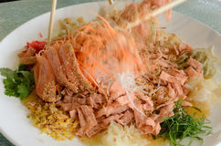 A special dish during Chinese New Year called Yusheng or Yee Sang Stock Photography