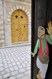Special doors in  Tunis Medina. Traditional nail door with yellow color and  drawing Stock Images