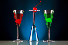 Special drinks. Colourful holiday cocktails on a black and blue backgorund royalty free stock images