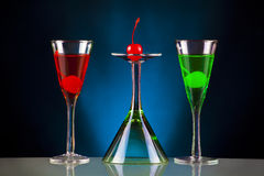 Special drinks. Colourful holiday cocktails on a black and blue backgorund Stock Photography