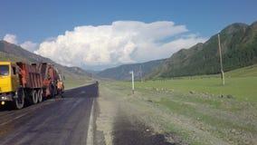 Special equipment repair roadway of Chuysky Trakt. Altai Republic, Russia - July 14, 2015: Special equipment repair roadway of Chuysky Trakt stock video footage
