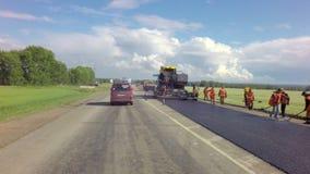 Special equipment repair roadway of Chuysky Trakt. Altai Republic, Russia - July 14, 2015: Special equipment repair roadway of Chuysky Trakt stock footage