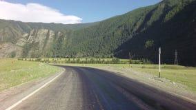 Special equipment repair roadway of Chuysky Trakt. Altai Republic, Russia - July 14, 2015: Special equipment repair roadway of Chuysky Trakt stock video