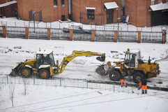 Special equipment on road construction. Snowfall. Stock Photography
