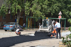 Special equipment on road repair. Asphalt laying. Stock Photos