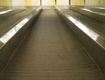 Special escalator in modern mall for people with. Supermarket carts and disabled people Royalty Free Stock Photography
