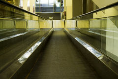 Special escalator in modern mall for people with. Supermarket carts and disabled people Royalty Free Stock Images