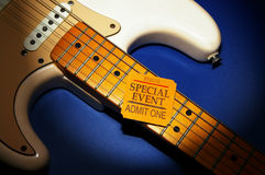 Special event. Ticket stub on a electric guitar Royalty Free Stock Photos