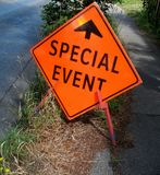 Special event sign with arrow. On a street Royalty Free Stock Photo