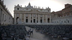 Special event in St. Peter's Basilica in Vatican City. Shot of hundreds of chairs placed in the main square of St. Peter's Basilica in Vatican City stock video