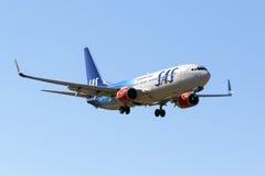 Special färgintrig SAS 737-800 Royaltyfri Foto