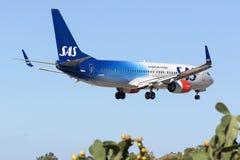 Special färgintrig SAS 737-800 Royaltyfri Fotografi