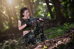 Special force with the gun in the jungle Stock Images