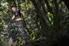 Special force with the gun in the jungle Stock Photos