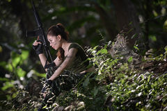 Special force with the gun in the jungle Stock Photography
