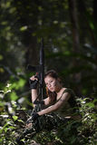Special force with the gun in the jungle Royalty Free Stock Photo