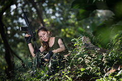 Special force with the gun in the jungle Royalty Free Stock Photography