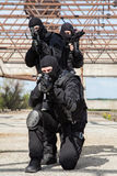 Special forces in action. Special forces operators in black uniform in action Royalty Free Stock Photo