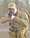 Special Forces. A special forces agent fires from cover Royalty Free Stock Images