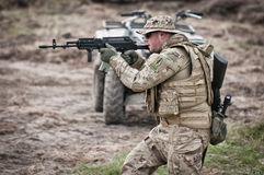 Special forces assault. Special forces soldier during assault on the battlefield royalty free stock images