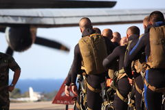 Special forces awaiting their mission. Special forces (of the french 2nd Foreign Parachute Regiment) wearing parachutes and scuba gear waiting to board a Stock Images