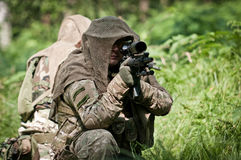 Special forces defending their ground. Special forces soldiers in forest during patrol, defending their position Royalty Free Stock Photo
