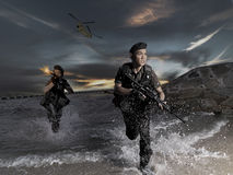 Special Forces Doing Beach Assault With Helicopter Stock Photography