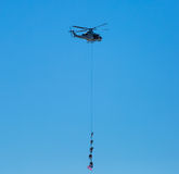 Special Forces. Hang from an insertion line attached to a helicopter Stock Images