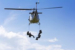 Special forces in helicopter with sky on background Royalty Free Stock Image