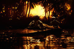 Special forces operators in the army kayak stock images
