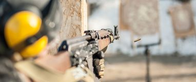 Special forces soldier in action, shooting from rifle machine gun royalty free stock photography