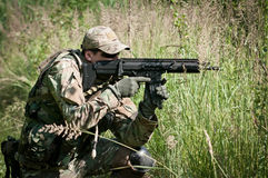 Special forces soldier aiming on enemy Royalty Free Stock Photo