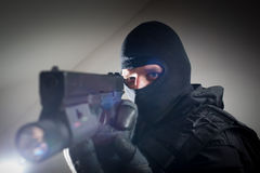Special forces soldier is aiming and shooting on the target. Special forces/ anti-terrorist police unit/private military contractor during night CQB hostage Stock Photography