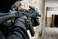 Special forces soldier armed with assault rifle ready to attack Stock Photo