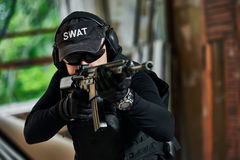 Special forces soldier armed with assault rifle ready to attack Stock Photography