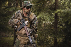 Special Forces soldier with assault rifle. Special Forces soldier with an assault rifle in the forest Royalty Free Stock Photo