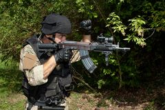 Special Forces soldier with an assault rifle Stock Images