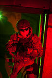 Special forces soldier or contractor during night mission Stock Photos