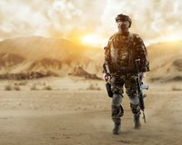 Special forces soldier in the desert. A soldier of special forces walks through the desert Stock Photo