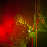Special forces soldier with gas mask during night mission Stock Photo