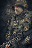 Special forces soldier man hold Machine gun on a dark background royalty free stock photography