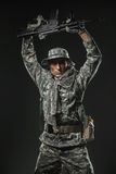 Special forces soldier man with Machine gun on a  dark background Royalty Free Stock Image
