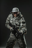 Special forces soldier man with Machine gun on a  dark background Royalty Free Stock Photography
