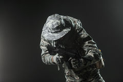 Special forces soldier man with Machine gun on a  dark background Royalty Free Stock Images