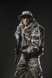 Special forces soldier man with Machine gun on a  dark background Stock Photos