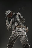 Special forces soldier man with Machine gun on a  dark background Stock Images